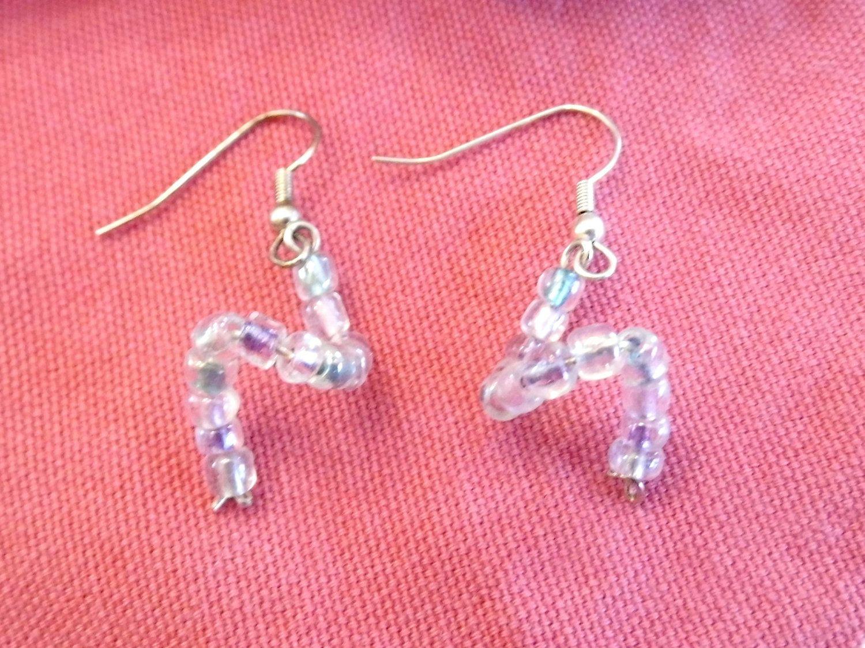 Handmade Fun Single Twisty Beaded Earrings in Pale Pink, Teal, Lavender. $7.95, via Etsy.
