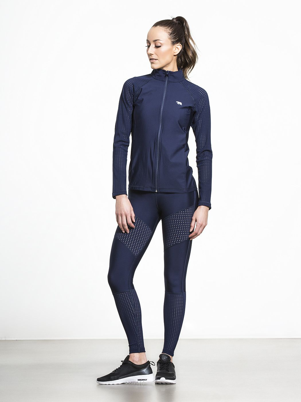 League of Her Own Cardio Zip Jacket by RUNNING BARE in Indigo Perforated