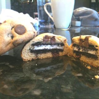 Chocolate stuffed Oreos.  Make chocolate chip cookie dough. Roll out large balls. Flatten one ball and place Oreo on top, fold sides onto the top to close it in. Careful not to press hard. Put on cookies sheet and into the fridge to cool about 30mins. Place in oven @ 350 for 20mins or until golden brown. Not overly sweet. Great for special events.