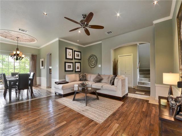 Hardwood Floors Against Cream Colored Furniture And Seafoam Green