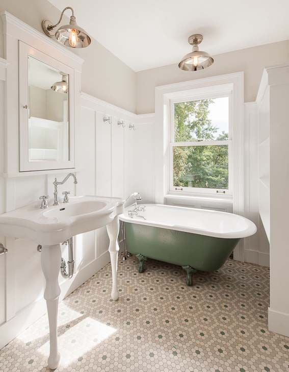 Clawfoot Tub With Green Base Is The Center Of This Bright Light Bathroom Intricate Tile Floor
