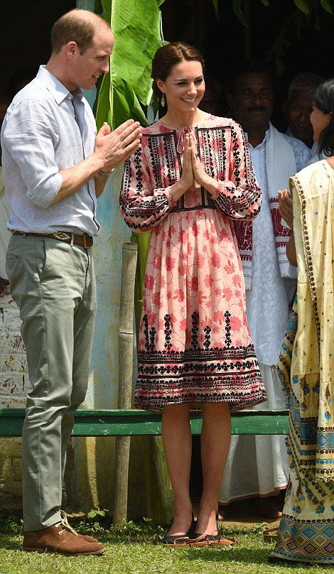 Prince William, Duke of Cambridge and Catherine, Duchess of Cambridge greet a villager in Pan Bari Village, Assam, India, during day four of the royal tour to India and Bhutan