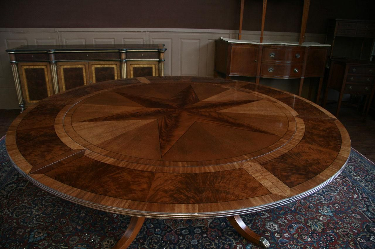 Round Mahogany Dining Table Shown With Leaves Seats 10 People