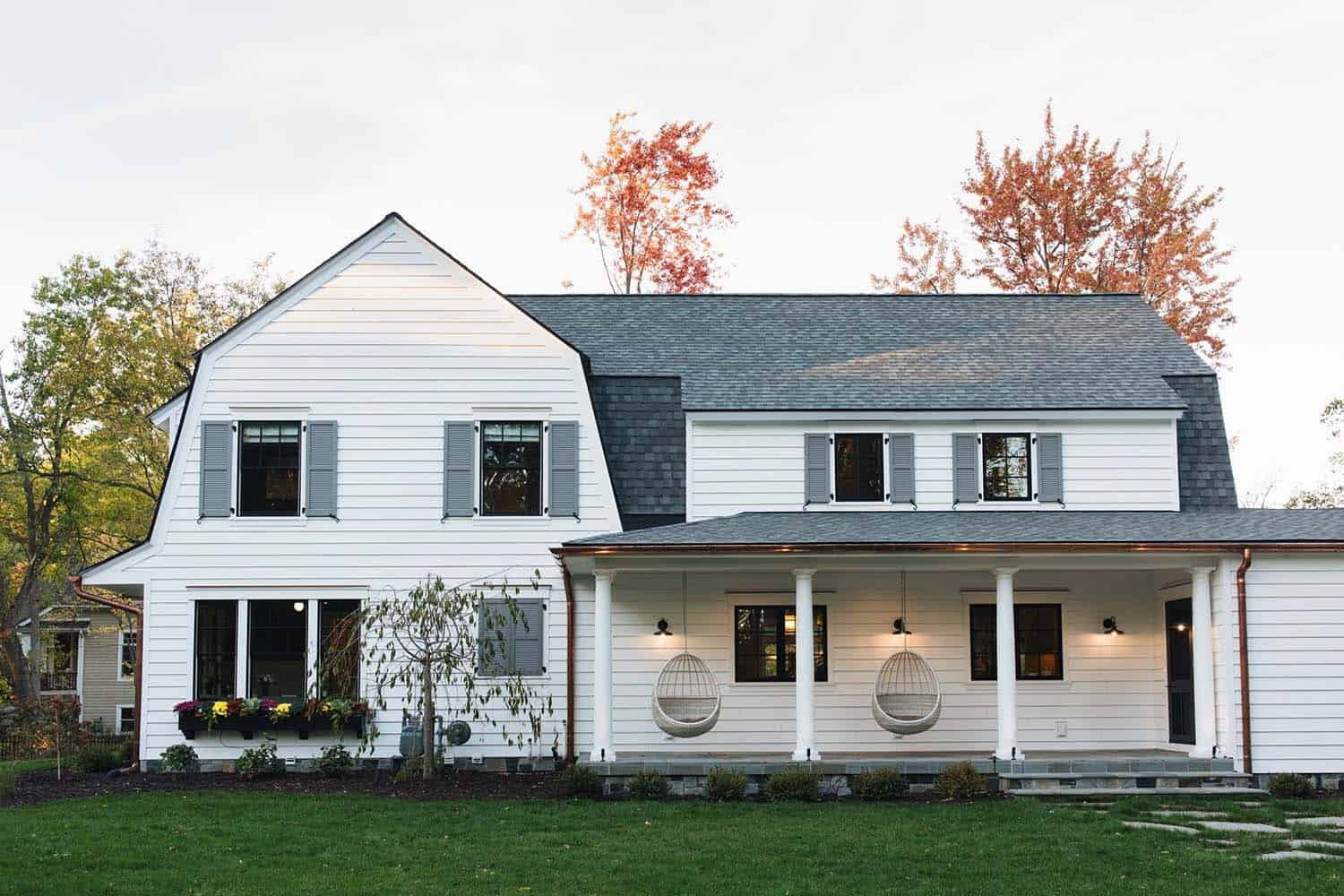 Delightful Modern Farmhouse Style Home Nestled In East Grand Rapids Colonial House Exteriors Farmhouse Style House Dutch Colonial Exterior