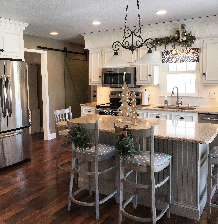 Modern farmhouse style kitchen with sliding barn door ...
