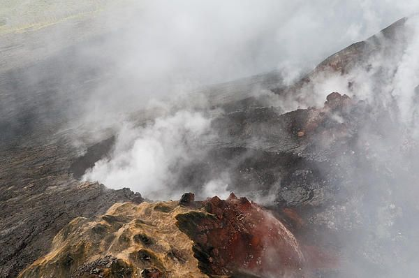 Aerial photography from open door helicopter over the smoking fields, craters and live volcanoes of Hawaii Island (aka the Big Island of Hawaii)