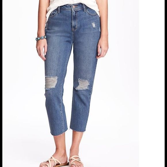 Vintage High-Rise Jeans 100% cotton. Button closure and zip fly. Scoop pockets and coin pocket in front; patch pockets in back. Soft, medium-weight denim is slightly distressed for a lived-in  High rise. Relaxed through hip and thigh. Old Navy Jeans Ankle & Cropped