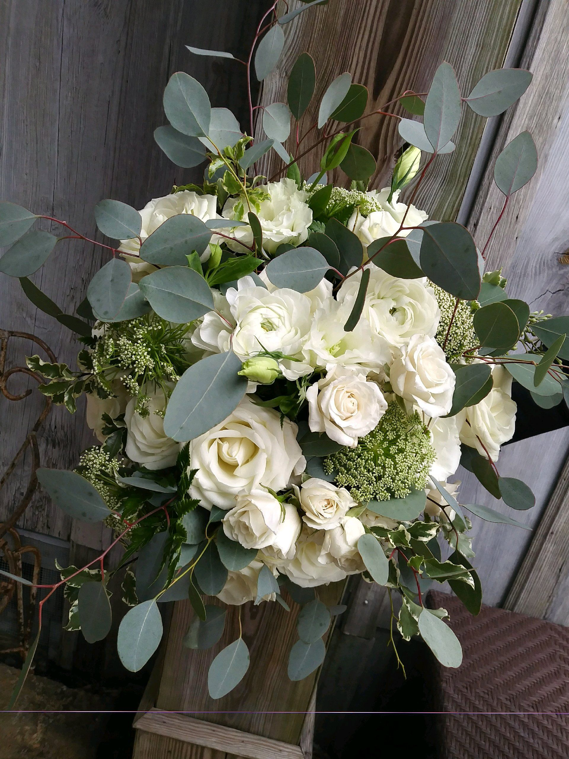 White bridal bouquet with roses, ranunculus, queen anne's