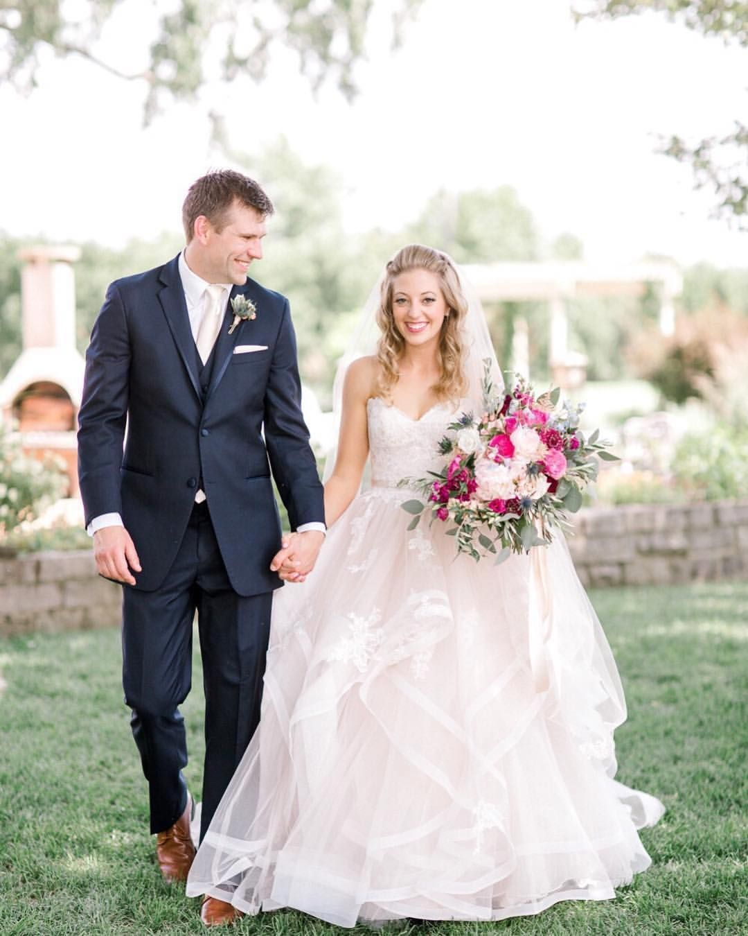 Wear your wedding dress on your anniversary  This couple her bouquet and that dress Dreamy  Come visit us