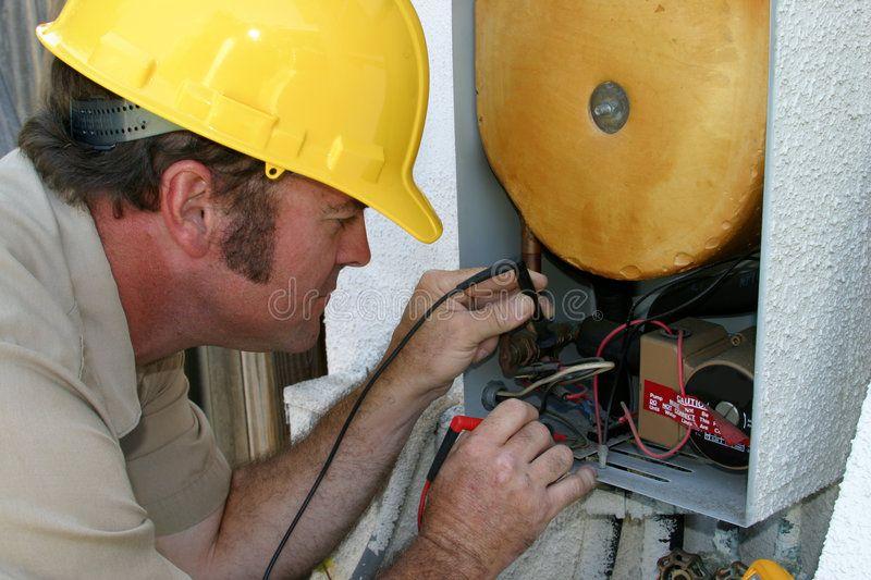 Ac Repairman Closeup A Closeup Shot Of An Ac Repairman Working On