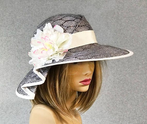 d79d52d109f43a This couture millinery hat was handmade on an antique hat block using a  novelty sisal straw. This lovely hat is embellished with a silk flower.