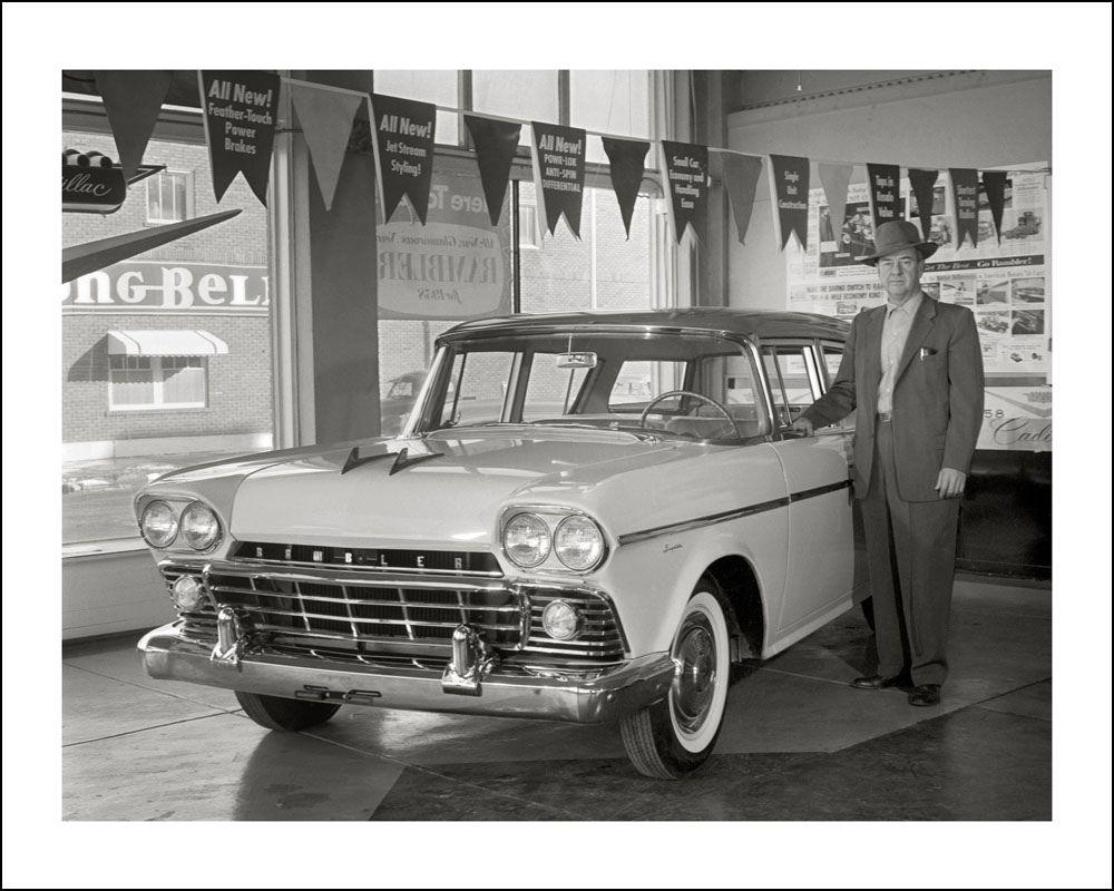 A Parsons, Kansas car salesman with a new 1958 Dodge Rambler ...