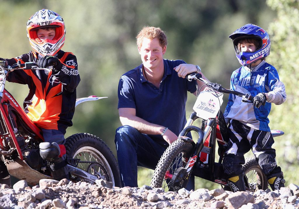 Prince Harry poses with trail bike riders at an outdoor centre in the foothills of the Andes on June 29, 2014 in Antaeaya, Chile. Prince Harry is on the final day of a three day tour of Chile after visiting Brazil