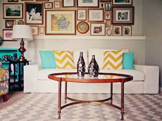 I love the various chevron designs and the yellow and aqua pops... It looks like there's an aqua bookcase and maybe a chevron chair on the left side... Wonderful!