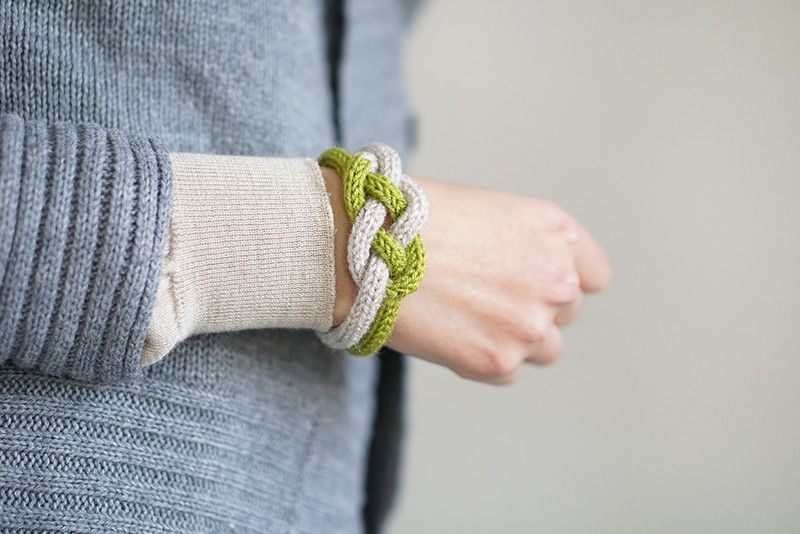 Hand knitted rope bracelet, made of yarn with modern colors and feminine design. It has interesting knot at the middle. Very comfortable and lightweight. It will be a great addition to your...
