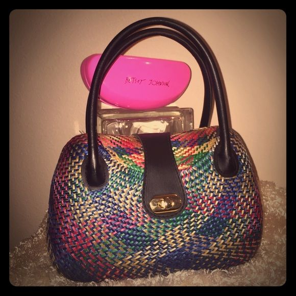 """Multi Colored Hard Shell Mini Basket Like Bag Excellent condition multi colored woven mini basket like bag with black interior and a small open pocket. Two handles with a 6"""" drop and gold hardware and turn lock closure. 4 protective feet on bottom. Bags Mini Bags"""