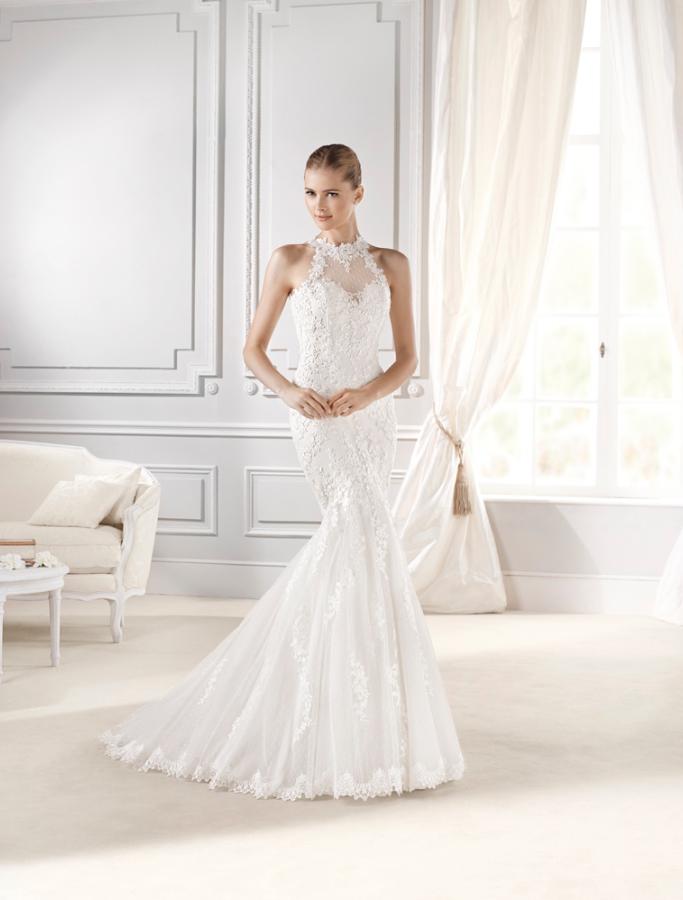 vestido de #novia con corte sirena, de encaje y de cuello alto