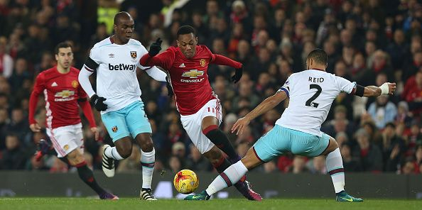 Anthony Martial Of Manchester United In Action With Winston Reid Of West Ham United During The Efl Cup Quarterfina Manchester United Manchester Anthony Martial