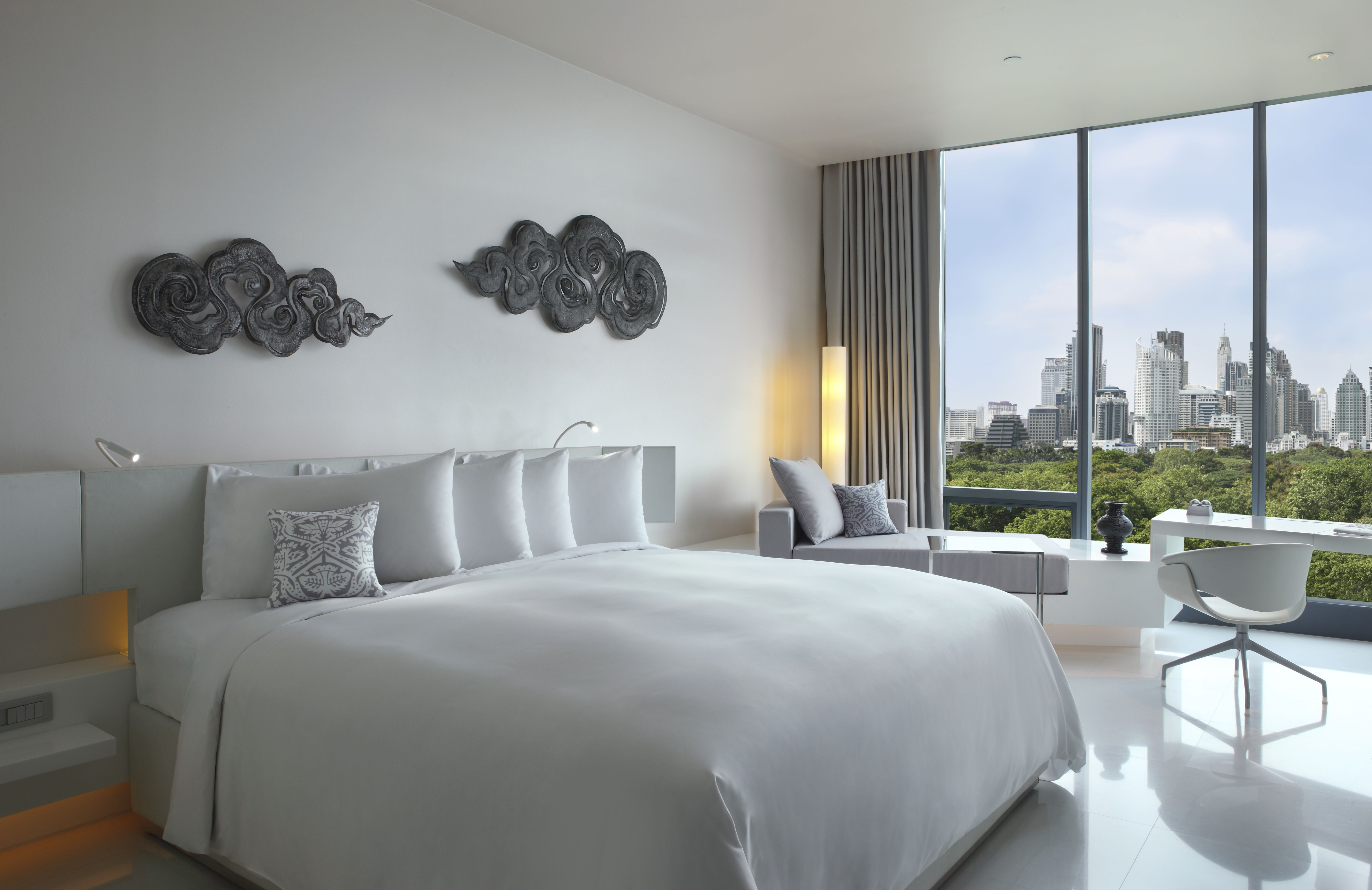So Comfy; Metal Element rooms represent Purity and Modernity. Somchai Jongsaeng, the designer of Metal element rooms is known for his philosophical approach in creating spaces as reflections of their locale. He has made the Metal element rooms simple and tranquil, immaculate spaces that are bright and welcoming through their different shades of white and sleek metallic details. #design #boutique #hotel #Bangkok #BTS #MRT #skytrain #Sathorn #Sukhumvit #travel #idea