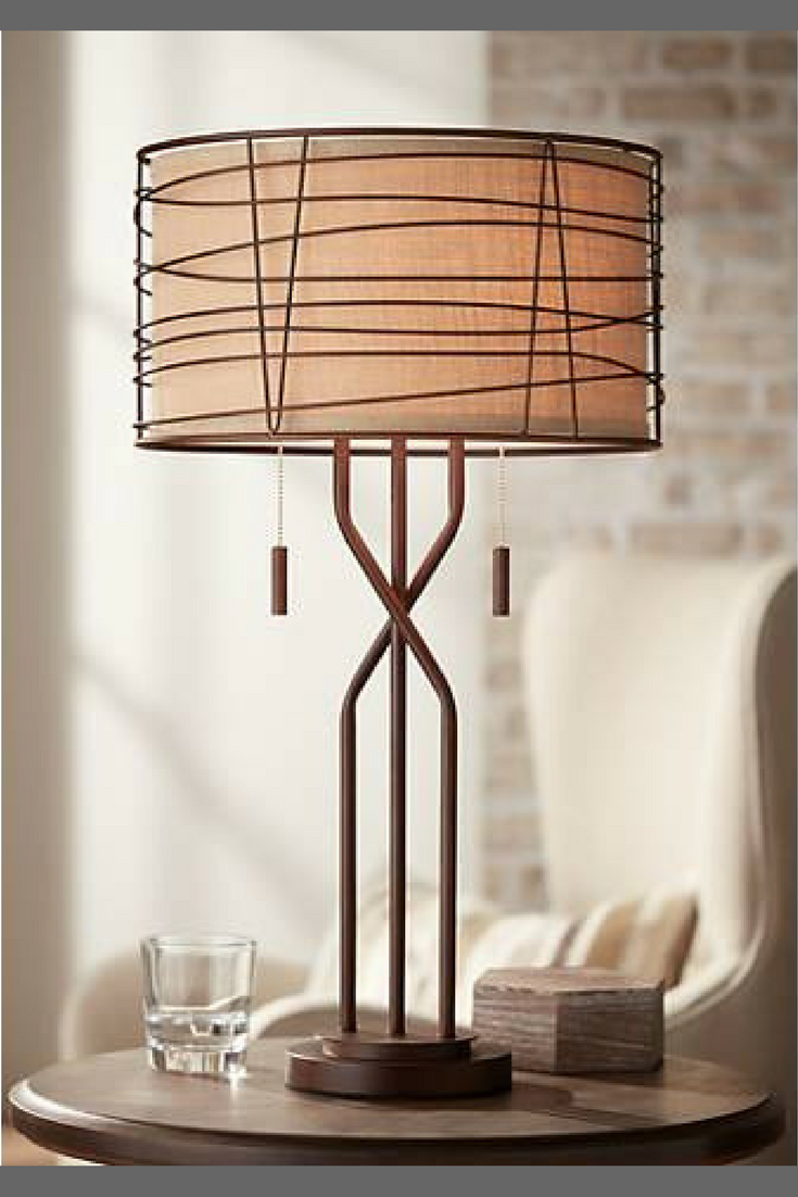 With a stunning woven metal construction and a burlap shade