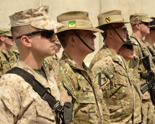 Soldiers From The 1st Cavalry Division Australian And Marines Listen To History Of Patch While Standing In Formation During