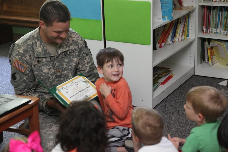 Major May, 1252 BN XO, shares a moment with little ones