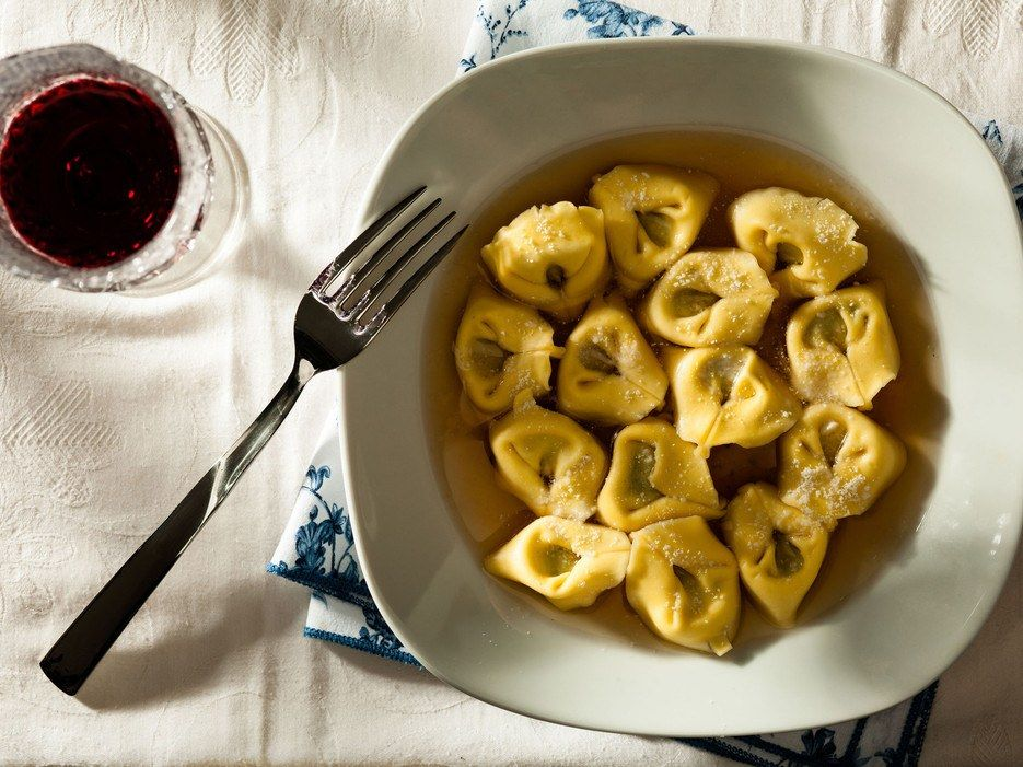 For many families in northern Italy, specifically Emilia-Romagna, tortellini en brodo is a staple dish, particularly during the holidays. Unlike typical tortellini, served in a heavy cream sauce, these float naked in a simple, homemade chicken broth (kind of like the Italian version of wonton soup, except filled with veal and Parmigiano Reggiano cheese). It's topped with a light sprinkling of grated Parmesan—and that's it. You'll never want to eat tortellini any other way. Try it at: Gioia…