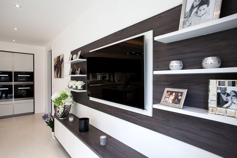 Brilliant white glossy lacquer kitchen with dark pine