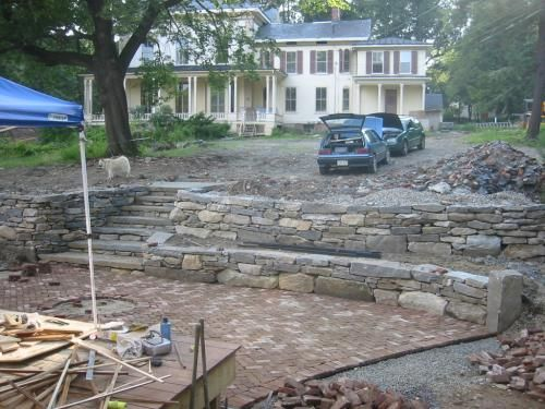 Stone Steps Up Through Feildstone Wall And Terrace With Recycled Brick Patio