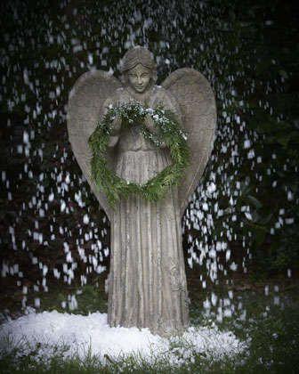 Angel Wreath Holder at Neiman Marcus.