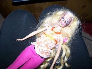 Best way to remove ink from Barbie's face:  acne cream.