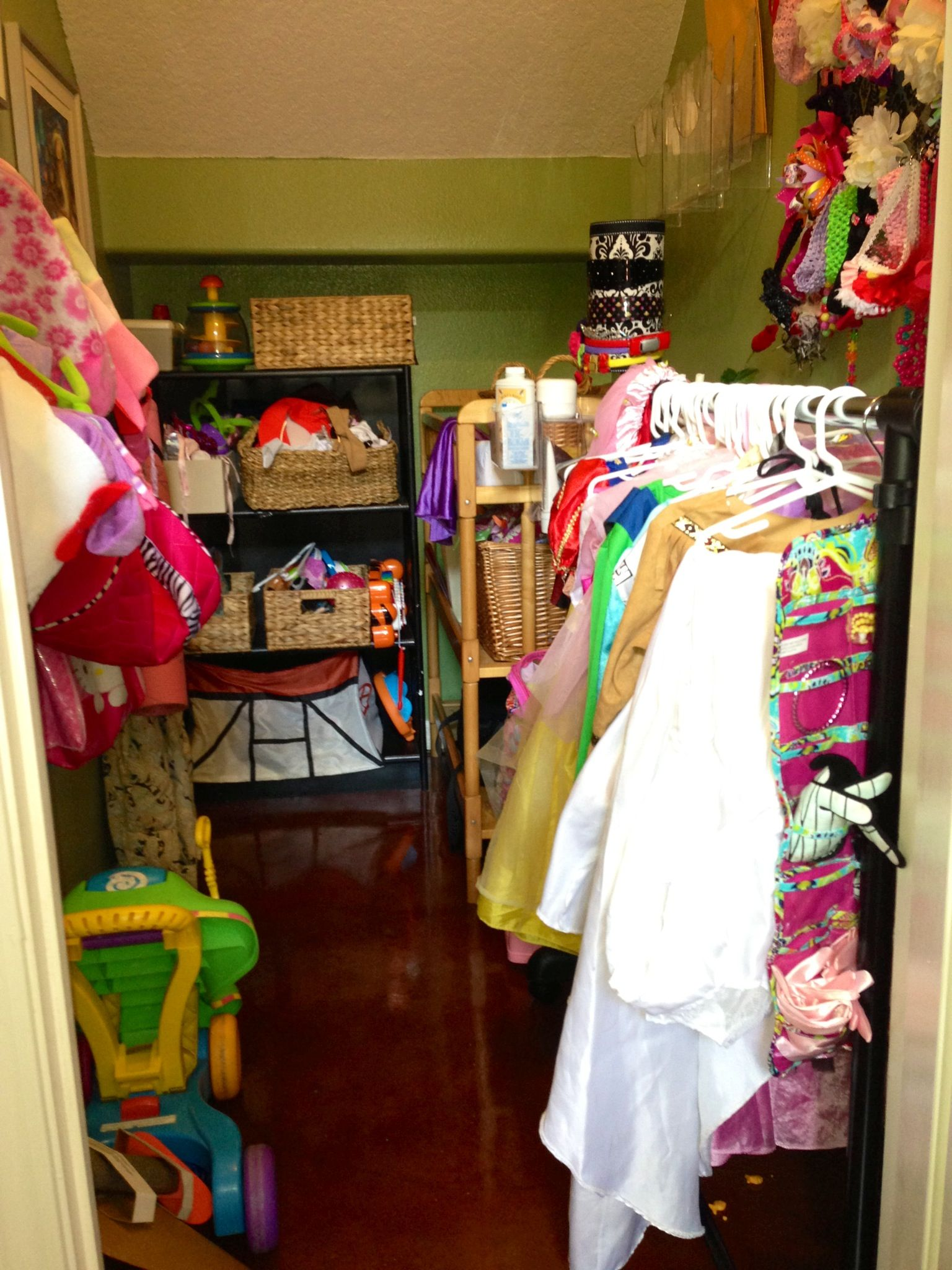 Our closet under the stairs is used to organize the dress up