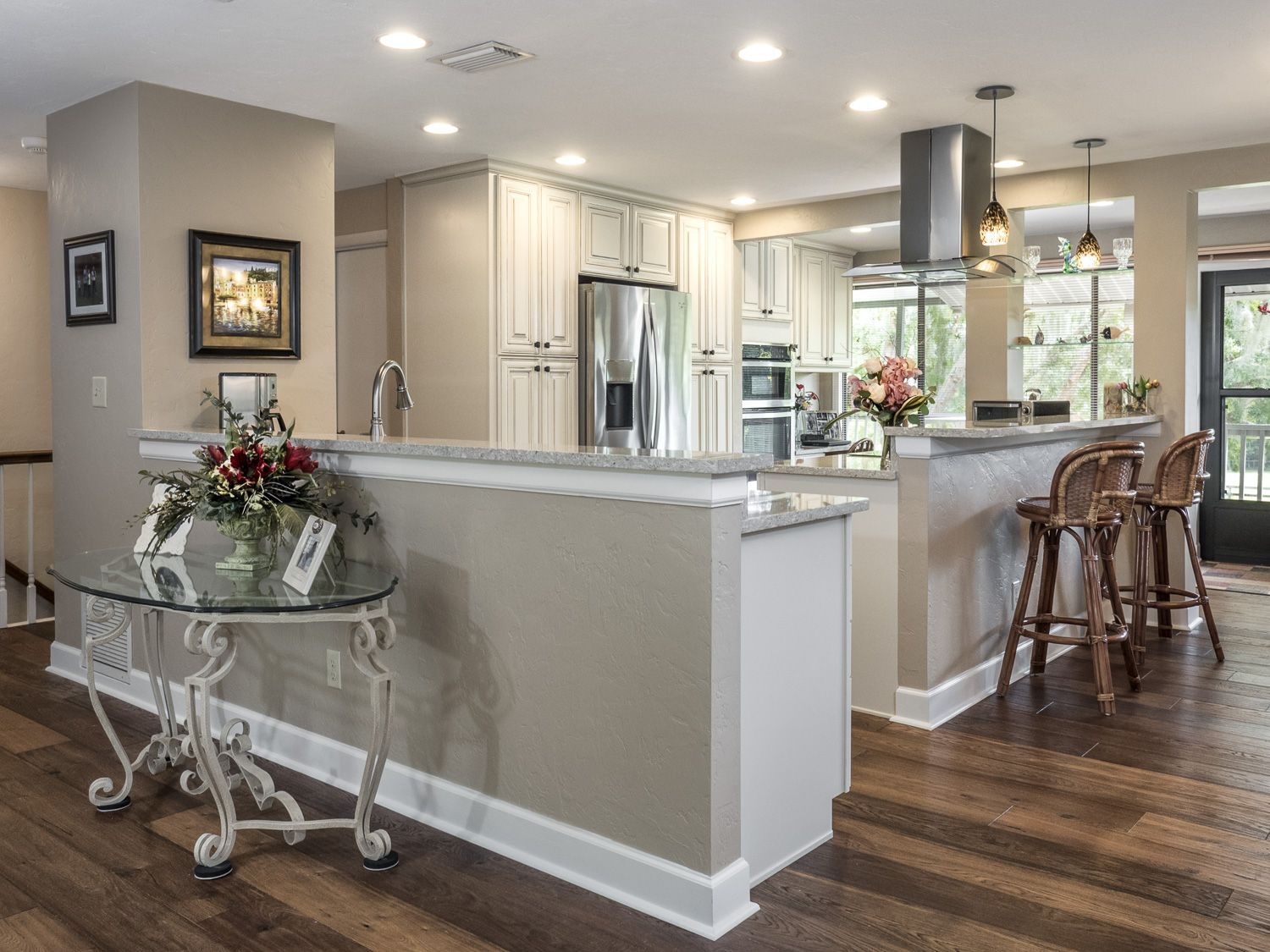 Open Kitchen In Cream Colored Cabinets Wood Floors Stainless