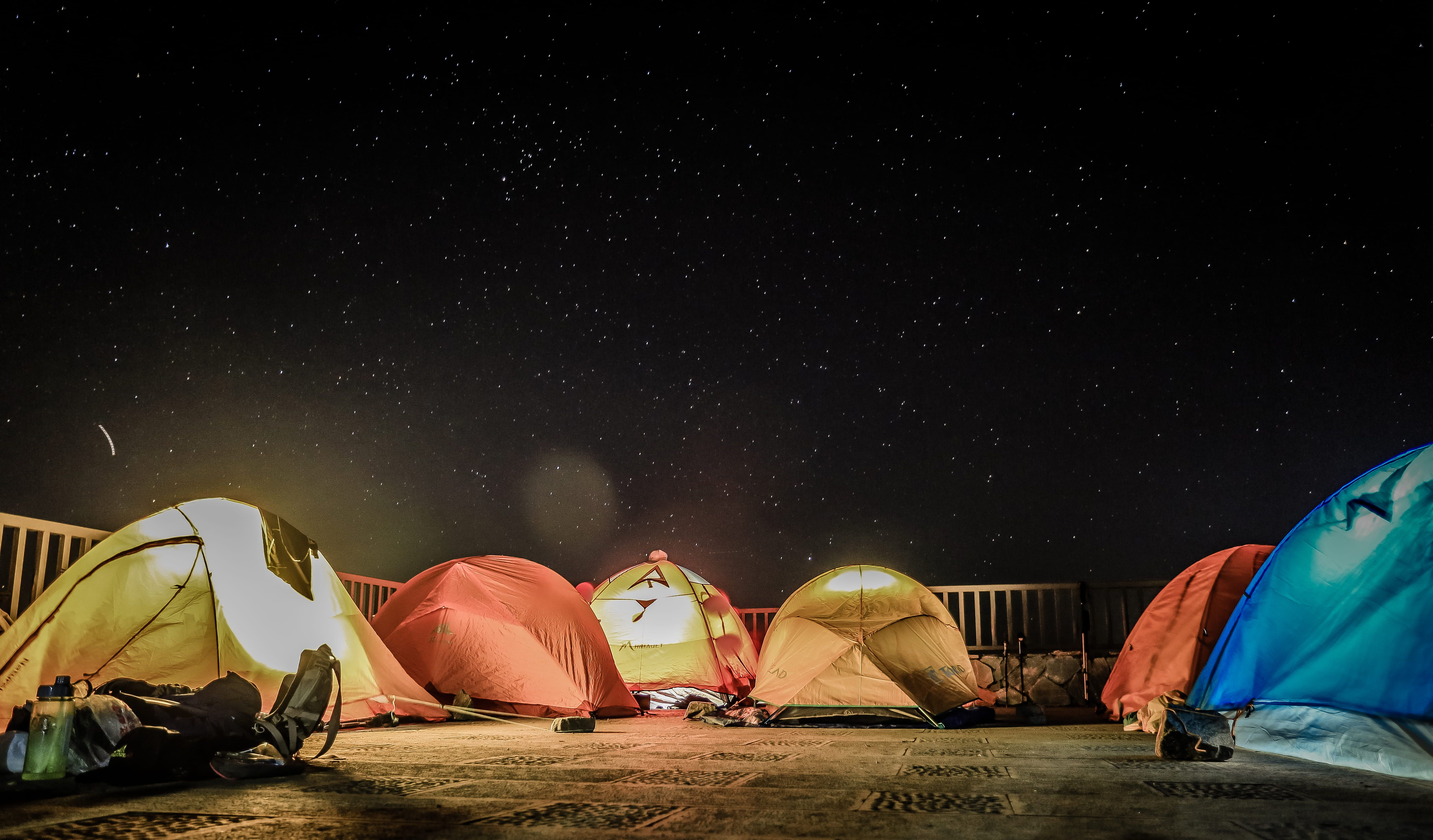 Assorted Color Dome Tents Beside Fence Camping Tents Under Starry Sky Camping Tent Dark Night Illumin In 2021 Tent Family Camping Photography Camping Photography