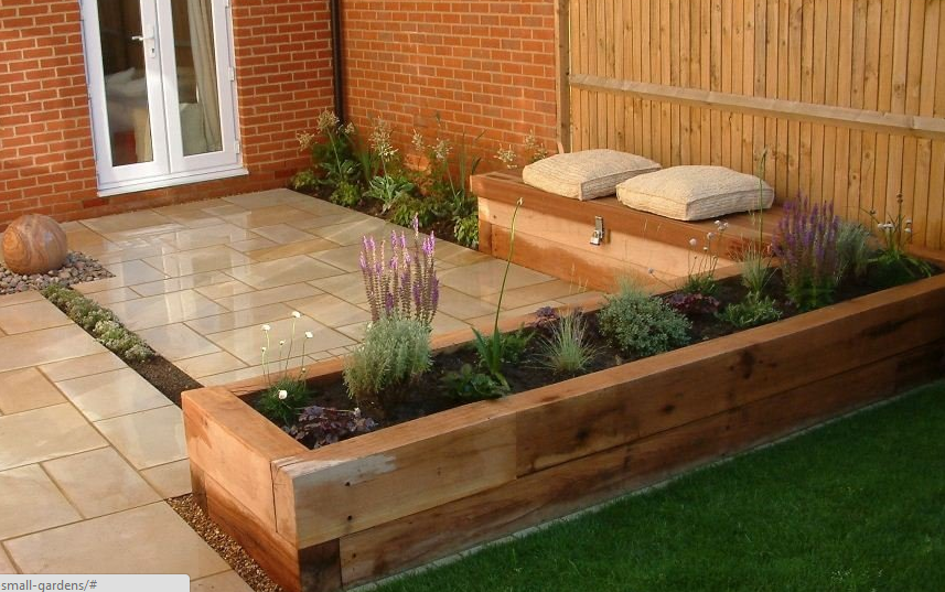 Raised bed, seating, storage and patio all in one! Patio
