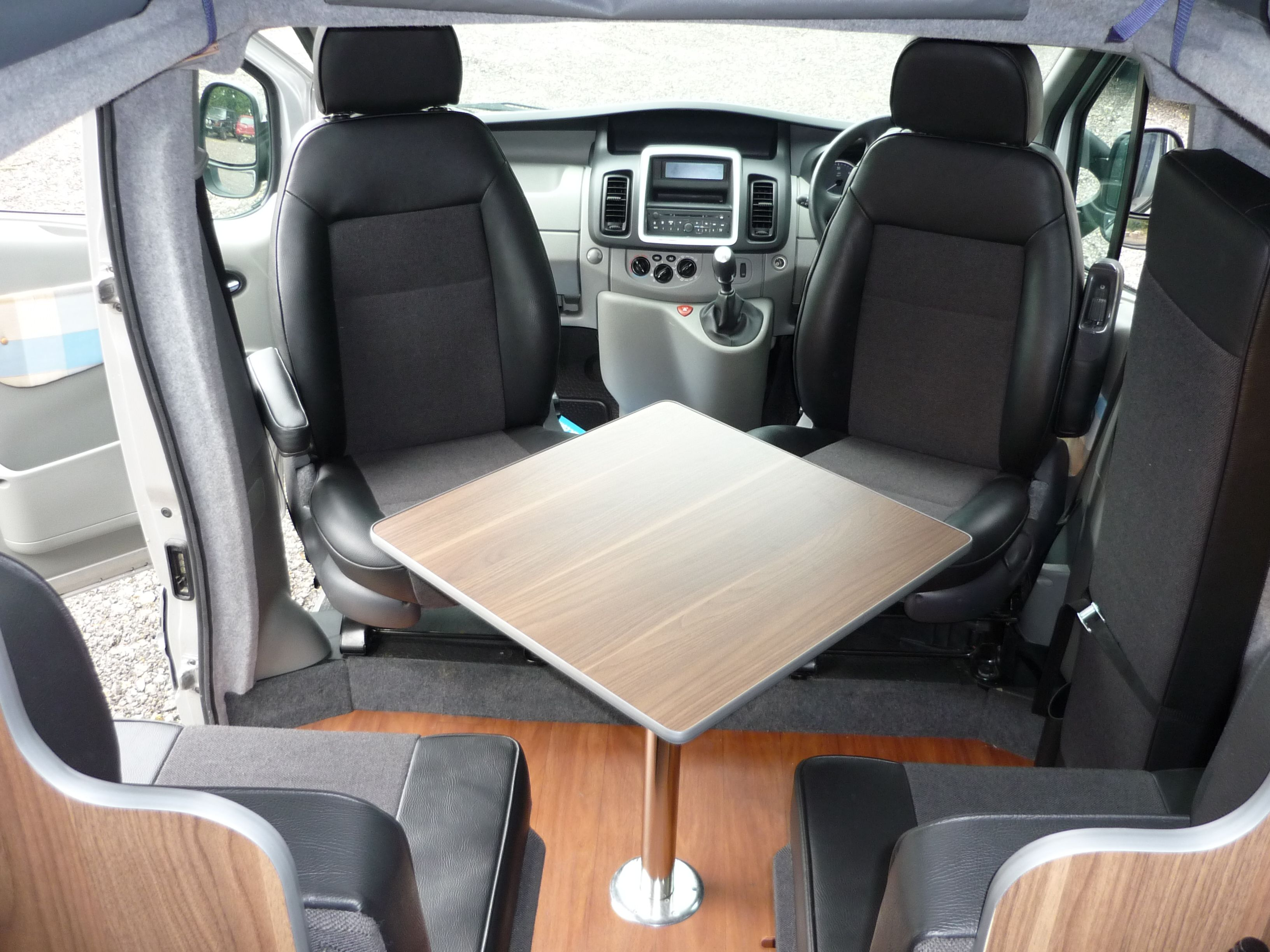 Campervan Conversion With Four Seats Around Table Including Two Swivel Front