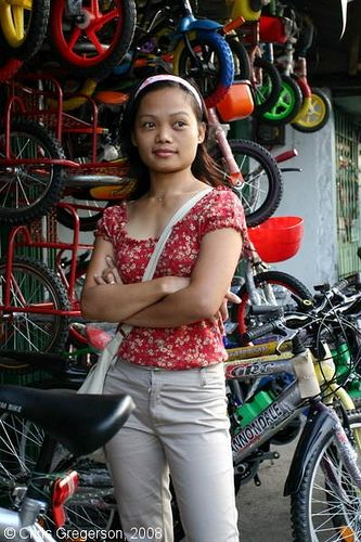 Woman Standing Outside A Bike Shop In Angeles City Philippines