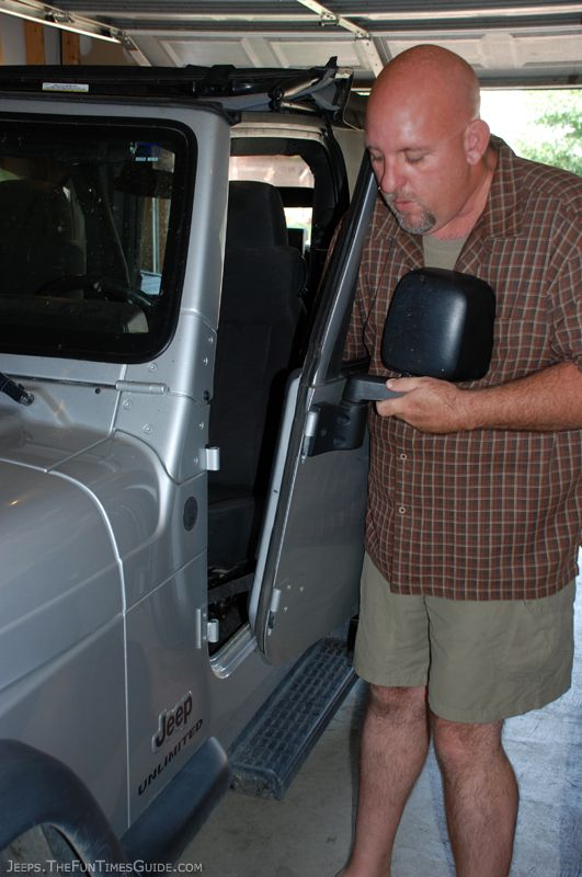 Holding the Jeep door we just removed from its hinges.