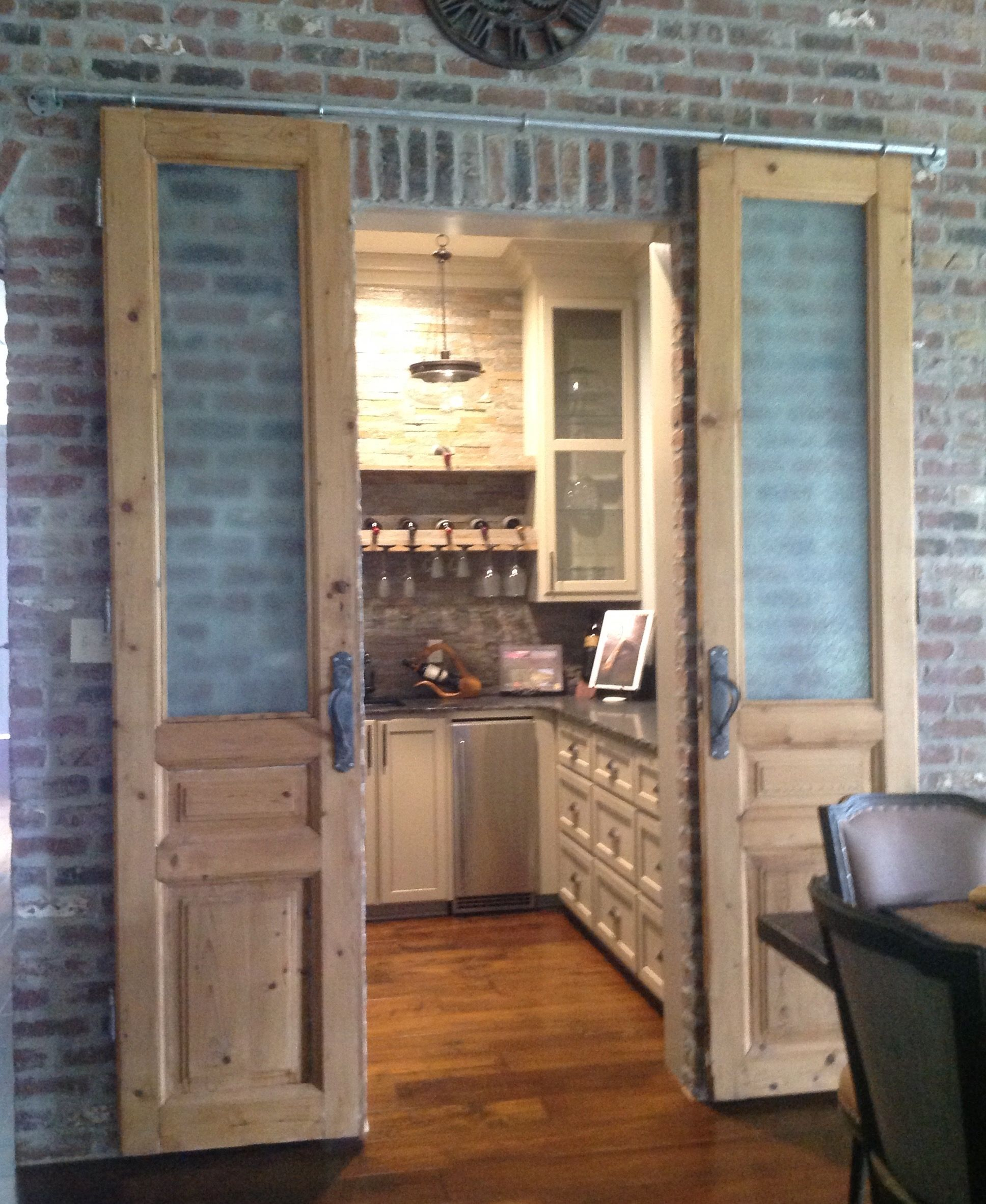 Antique doors into our butlers pantry with our DIY barn door sliding hardware. & Antique doors into our butlers pantry with our DIY barn door ... pezcame.com