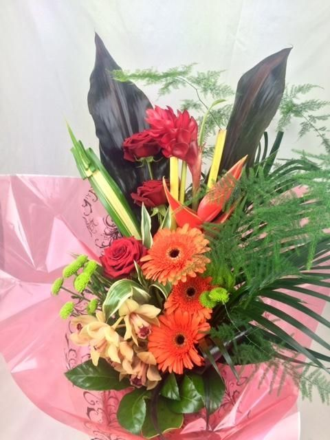 Our Tropical Delight Bouquet is sure to make a big impact ...
