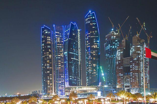 Abu Dhabi Skyline By Night United Arab Emirates Abu Dhabi Abu Dhabi Travel High Rise Building