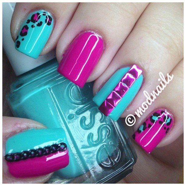 Love the colour combo on these nails but there is way too much going on for my liking. The studs and animal print are killer though!