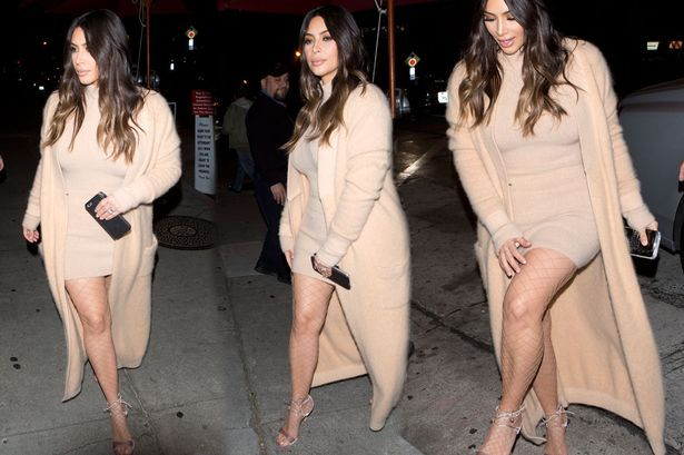 Kim Kardashian flashes her underwear as she steps out in nude mini-dress