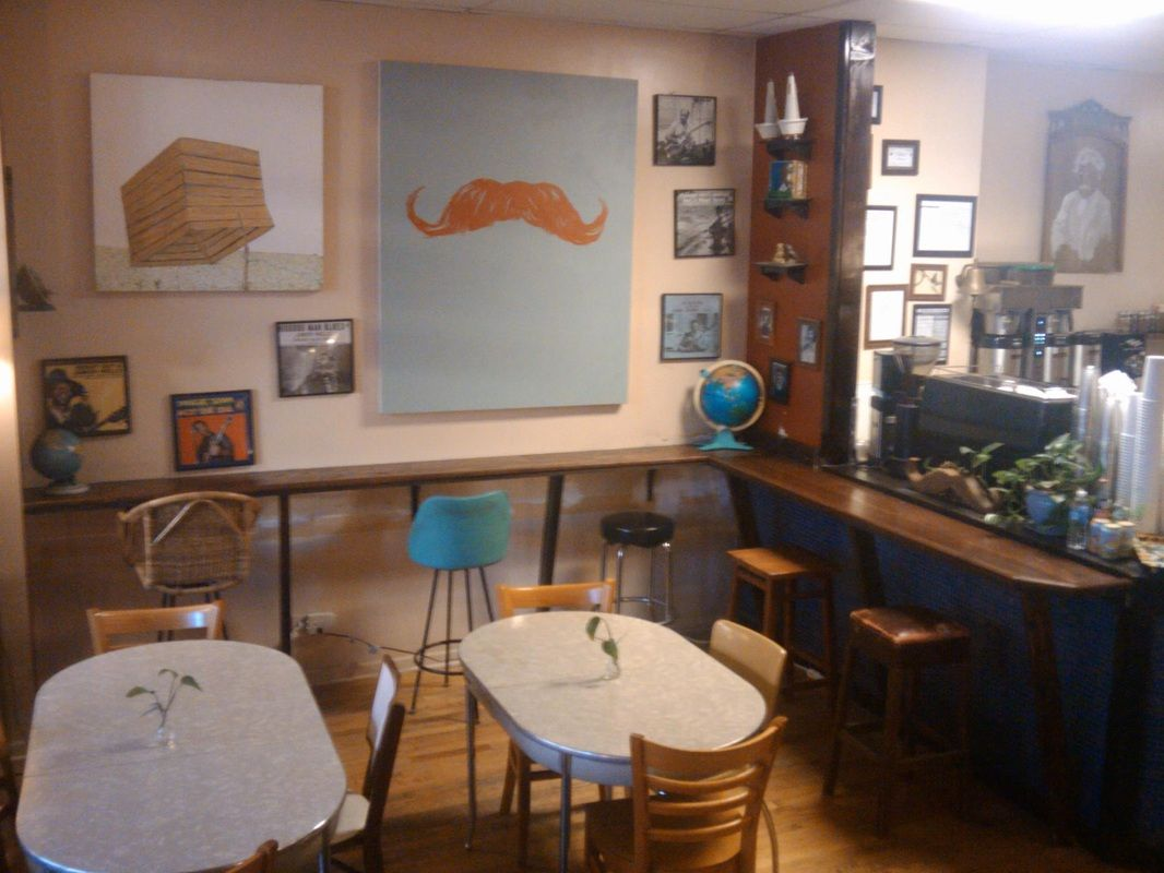 Cafe Mustache: A Cafe, Bar, and Venue in Logan Square.