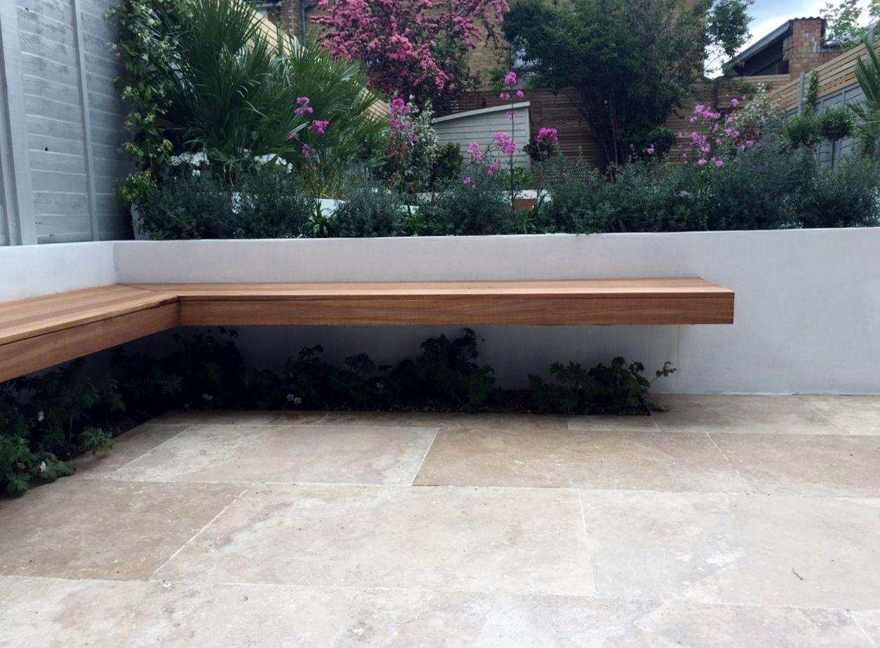 travertine paving beige cream ivory colour paving installation modern garden design london