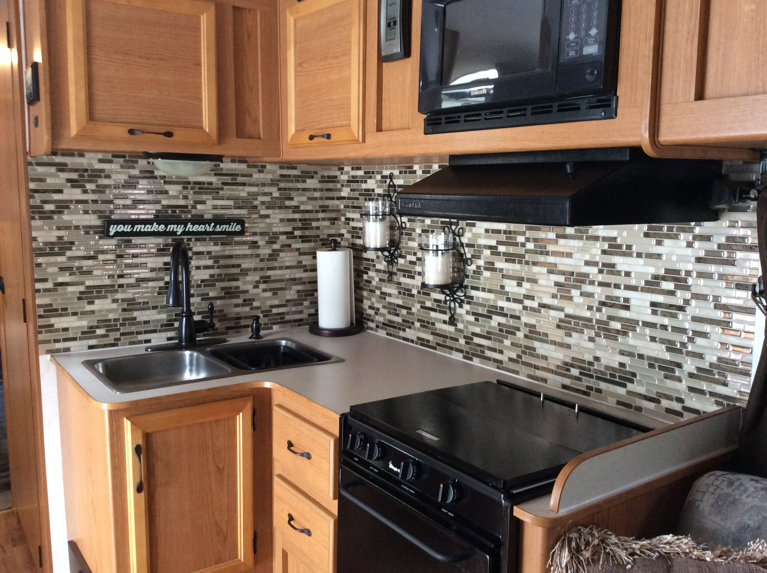 We installed these beautiful Smart Tiles Peel and Stick Backsplash tiles in our RV kitchen