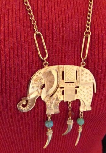 Try this large beaded elephant pendant #necklace with a mix of animal prints or dark solids for an exotic look.  #Stuff4uand4u  #vintage  http://stores.ebay.com/Stuff4Uand4U