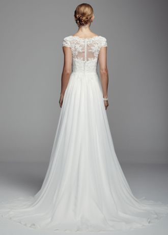 Elegant and timeless, this classic chiffon sheath gown will put you center stage on your special day!  Cap sleeve chiffon sheath gown features delicate lace embellishment.  Chapel train. Available in Soft White. Sizes 0-14.  Fully lined. Back zip. Imported polyester. Dry clean. To preserve your wedding dreams, try our Wedding Gown Preservation Kit.