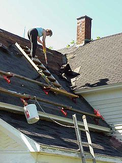 Re Roofing: Tearing Off Old Shingles, Adding New Sheathing, Installing Drip  Edge