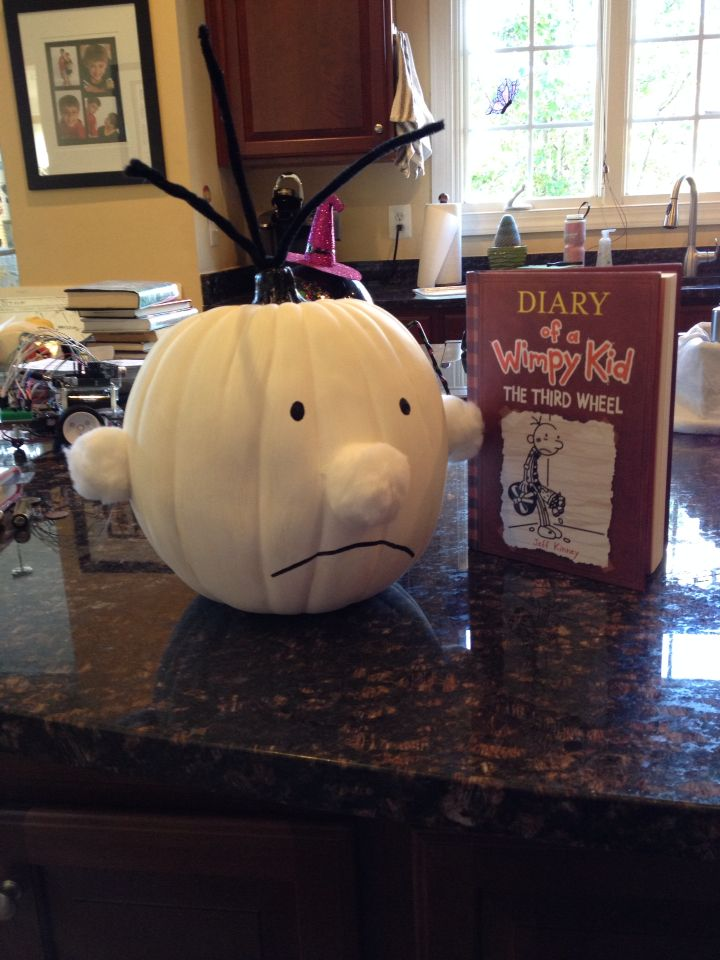 Diary of a Wimpy Kid pumpkin! I twisted two pipe cleaners together to make thicker strands of hair, (punched a hole in the top with a screwdriver and a hammer)